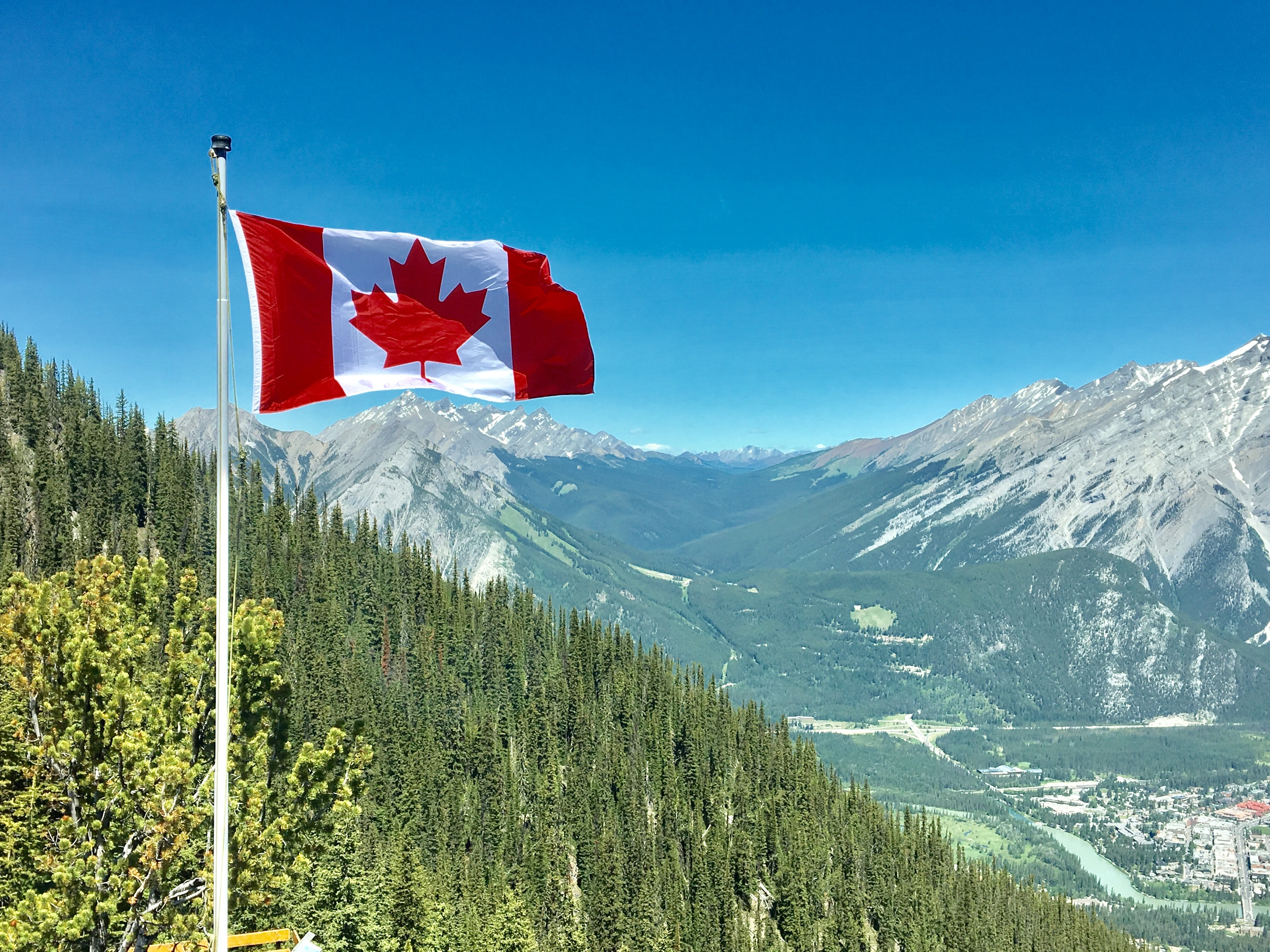 Canadian flag hoisted high in on the hills energy.