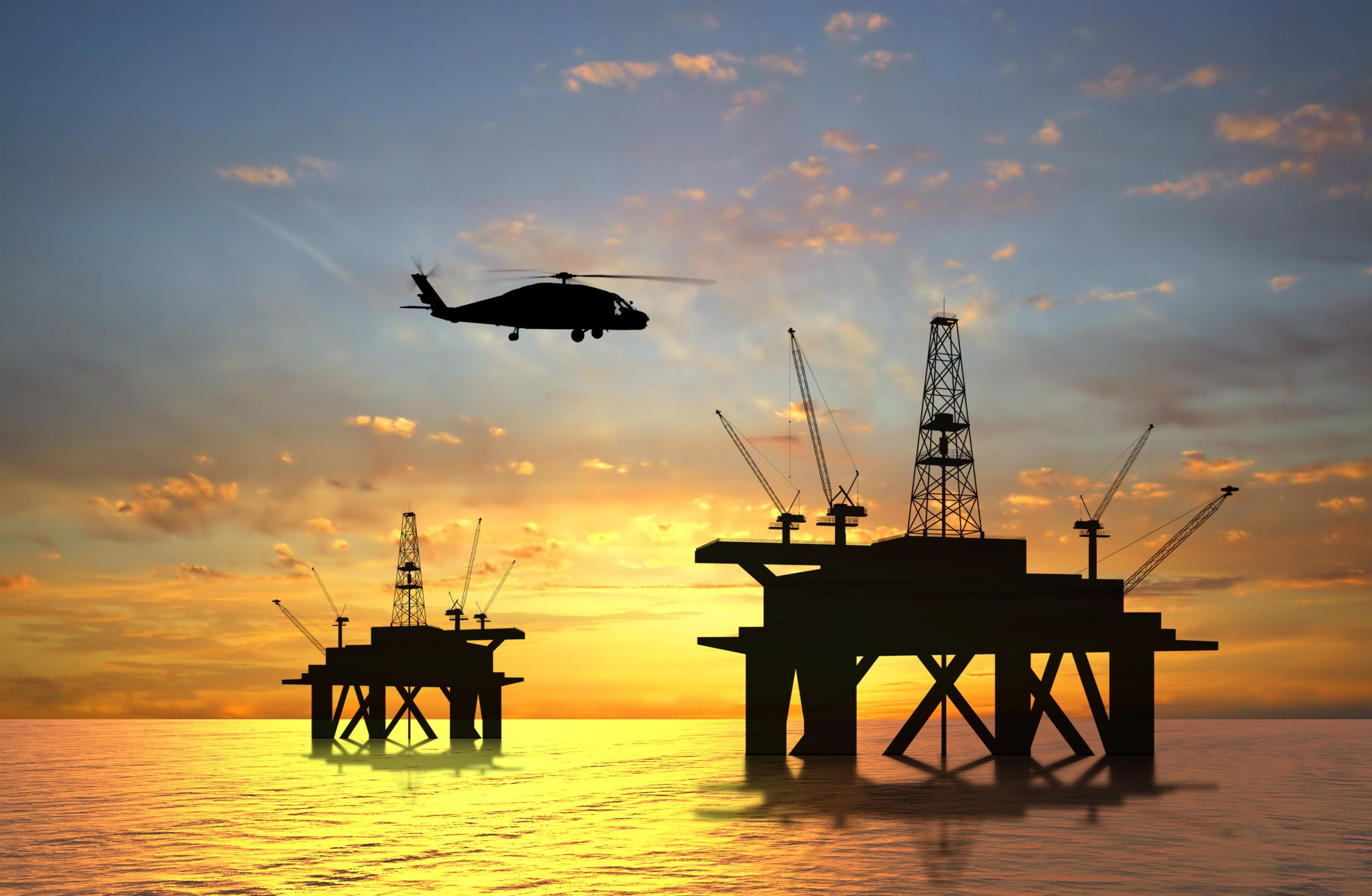 Photograph of oil drilling set up during sunset conceptual.