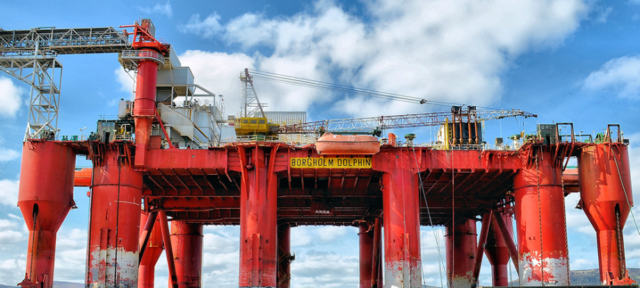 A huge red oil rig labelled Borgholm Dolphin of saudi